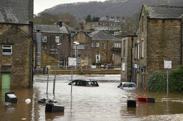 Cars are seen submerged as flood water covers the roads and car parks in Mytholmroyd, northern England, on February 9, 2020, after the River Calder burst its banks as Storm Ciara swept over the country.. (AFP Photo)