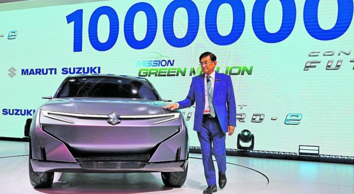 Kenichi Ayukawa, Chief Executive Officer of Maruti Suzuki India Ltd., poses with concept Futuro-e car after it was unveiled at the India Auto Expo 2020 in Greater Noida recently. (Reuters Photo)
