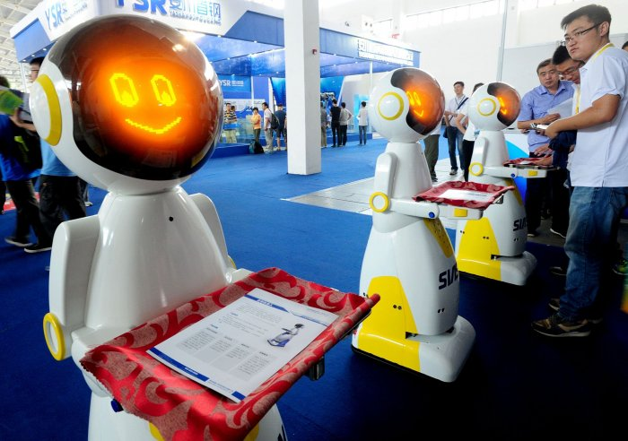 """Keenon Robotics Co, a Shanghai-based company, deployed 16 robots of a model nicknamed """"little peanut"""" to a hospital in Hangzhou after a group of Wuhan travelers to Singapore were held in quarantine. (Photo: Bloomberg)"""