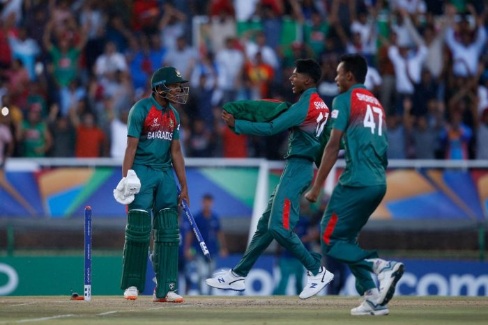 Bangladesh's Rakibul Hasan (L) celebrates with teammates after their victory over India during the ICC Under-19 World Cup cricket finals between India and Bangladesh at the Senwes Park, in Potchefstroom, on February 9, 2020. (AFP Photo)