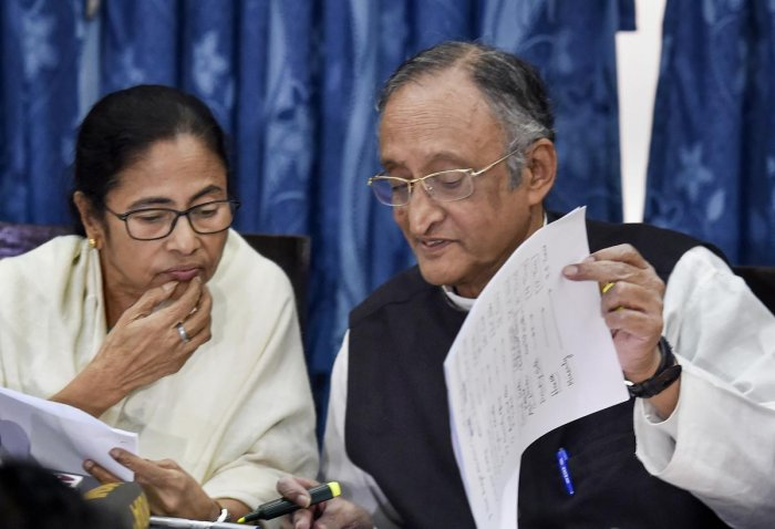 West Bengal Chief Minister Mamata Banerjee and Finance Minister Amit Mitra during a media interaction following the presentation of the State Budget 2020-21 in the State Assembly, in Kolkata, Monday, Feb. 10, 2020. Credit: PTI Photo