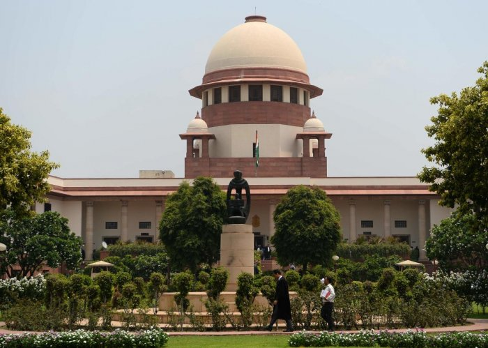 """""""How can you say that these facts were not placed before his excellency the President? How can you say that there was non-application of mind by the President,"""" the bench, also comprising Justices Ashok Bhsuhan and A S Bopanna, asked the lawyer. Credit: PTI Photo"""