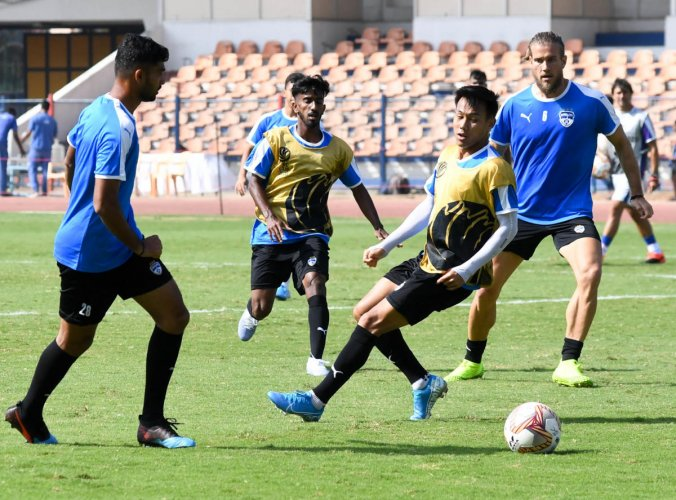 Bengaluru FC players sweat it out during a training session on the eve of their game against Paro FC in Bengaluru. DH Photo/ B H Shivakumar
