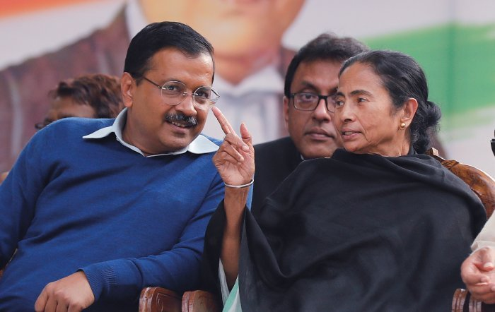 """Earlier, while talking to reporters in Bankura district, Banerjee had said that people in Delhi have rejected BJP's policies and that """"it was a victory of democracy"""". (Credit: Reuters Photo)"""