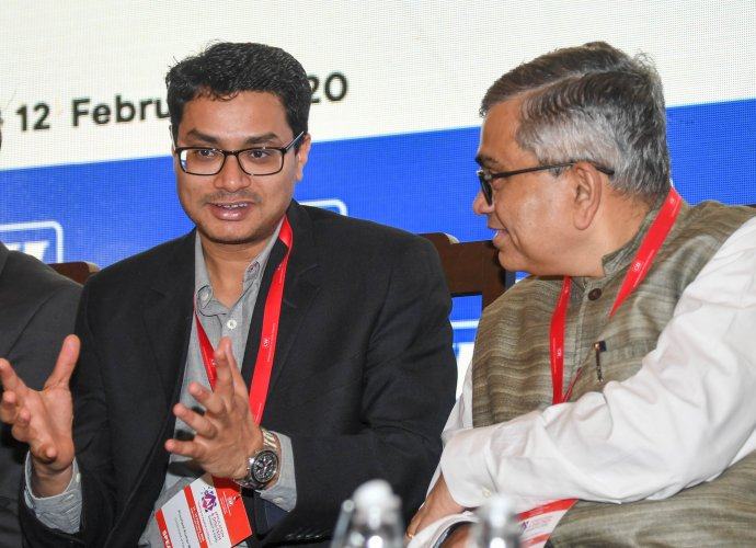 (From Left) Prashant Kumar Mishra, Director Department of IT &BT and MD, KITS GOK and Krishnakumar Natarajan, Co-Founder Mindtree are seen at the inaugural session of Ai Application & Digi-Tech Summit & Expo, organised by Confederation of Indian Iindustry (CII), at The Lalit Ashok, in Bengaluru. (DH Photo)