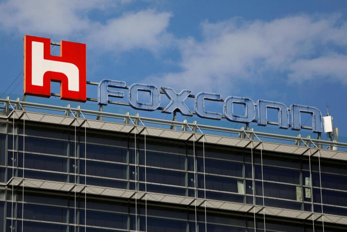 FILE PHOTO: The logo of Foxconn, the trading name of Hon Hai Precision Industry, is seen on top of the company's building in Taipei, Taiwan March 30, 2018. REUTERS/Tyrone Siu/File Photo