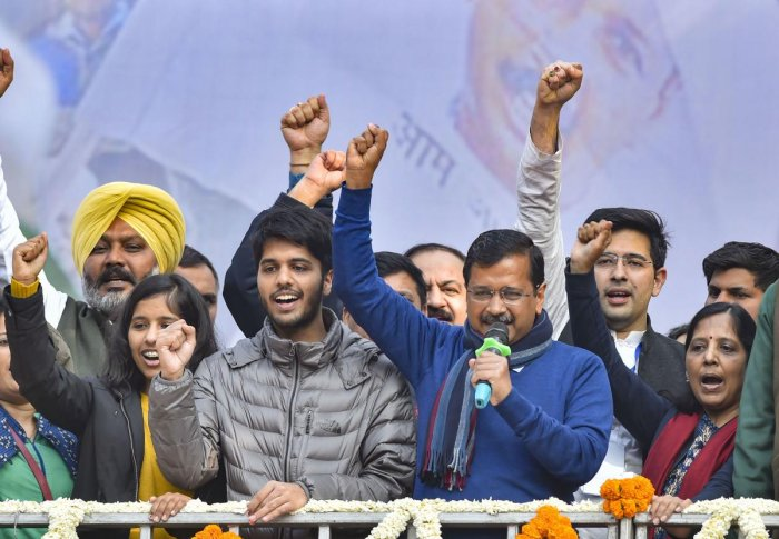 Delhi CM and AAP convenor Arvind Kejriwal (C) addreses supporters after party's victory in the State Assembly polls, at AAP office in New Delhi, Tuesday, Feb. 11, 2020. Kejriwal's wife Sunita, daughter Harshita and son Pulkit are also seen. (PTI Photo)