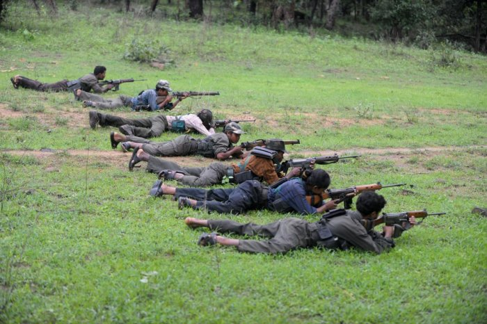 In this file photo taken on July 8, 2012 Indian Maoists ready their weapons as they take part in a training camp in Bijapur district in Chhattisgarh. (AFP Photo)