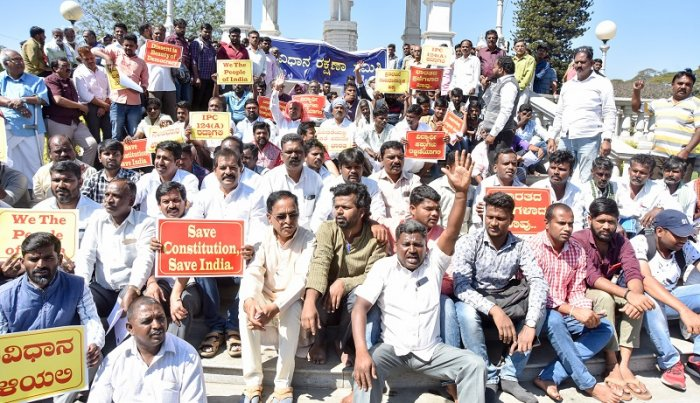Members of Constitution Protection Committee stage a protest, seeking withdrawal of sedition case against a student, who displayed 'Free Kashmir' placard', in Mysuru. (DH Photo)
