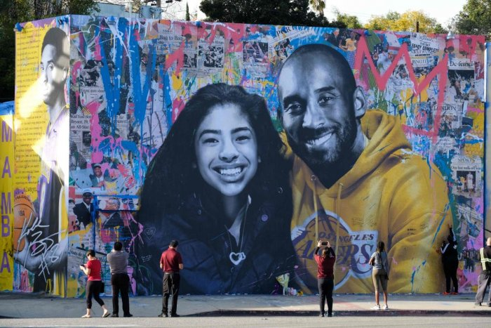 In this file photo taken on January 31, 2020 people take pictures of a mural by French artist Mr. Brainwash of late NBA legend Kobe Bryant and his daughter Gianna in Los Angeles. AFP File Photo