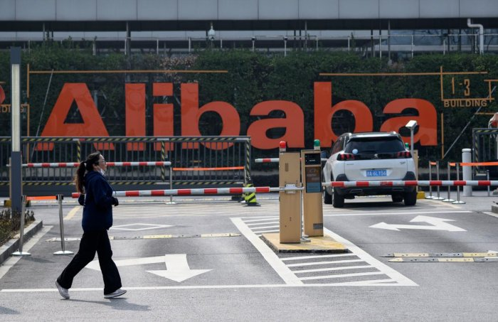 A woman jogs in front of the Alibaba headquarters in Hangzhou, some 175 kilometres (110 miles) southwest of Shanghai