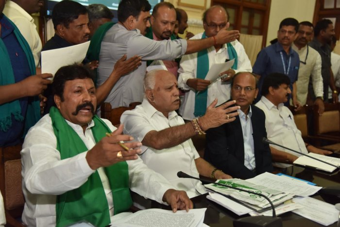 Chief Minister B S Yediyurappa and Agriculture Minister B C Patil gesture during a meeting with farmers at the Vidhana Soudha in Bengaluru on Thursday. dh photo