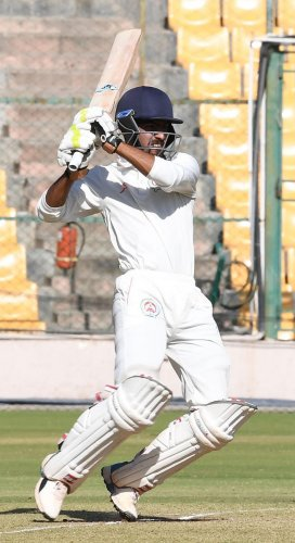 Ahmadnoor Pathan pulls en route 90 on the second day of Baroda's Ranji Trophy tie against Karnataka. DH PHOTO/ R SRIKANTA SHARMA