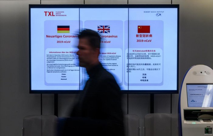 """An electronic billboard displays information on the """"Novel Corona virus"""" at Berlin's Tegel airport in Berlin on January 28, 2020. AFP file photo"""