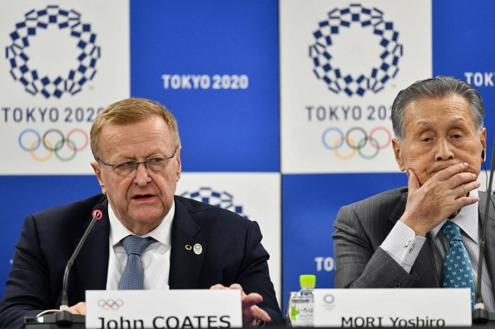 Chairman of the Tokyo 2020 Olympic Games coordination committee John Coates (L) and Tokyo 2020 president Yoshiro Mori (R) attend a press confernce following the International Olympic Committee (IOC) project review meeting in Tokyo. (AFP Photo)