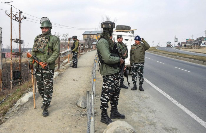 CRPF personnel stand guard at the spot where deadly 2019 Pulwama terror attack took place, at Lethipora of Pulwama District, South Kashmir. PTI