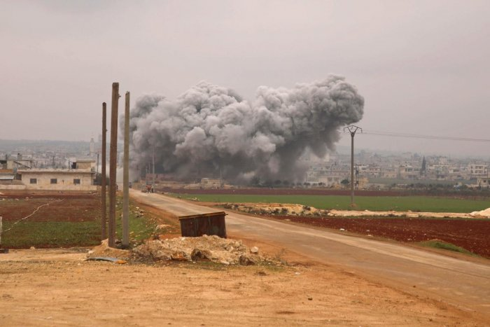 Smoke billows following a reported Syrian government air strike on the town of Atareb in the rebel-held western countryside of Syria's Aleppo province on February 13, 2020 as regime forces push on with their offensive in the country's northwest. (Photo by AFP)