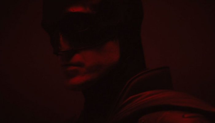 In the short clip, Pattinson, dressed as the caped crusader, is approaching towards the camera that is set in a dark room saturated in red light.
