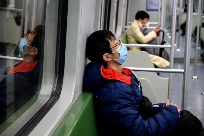 Zhang Hongxing, head of Wuhan's health commission, said last week the city tested about 6,000 to 8,000 people daily. (Credit: AFP Photo)