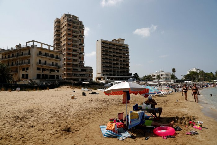 Abandoned buildings in Varosha, an area fenced off by the Turkish military since the 1974 division of Cyprus, are seen from a beach in Famagusta. (Reuters file photo)