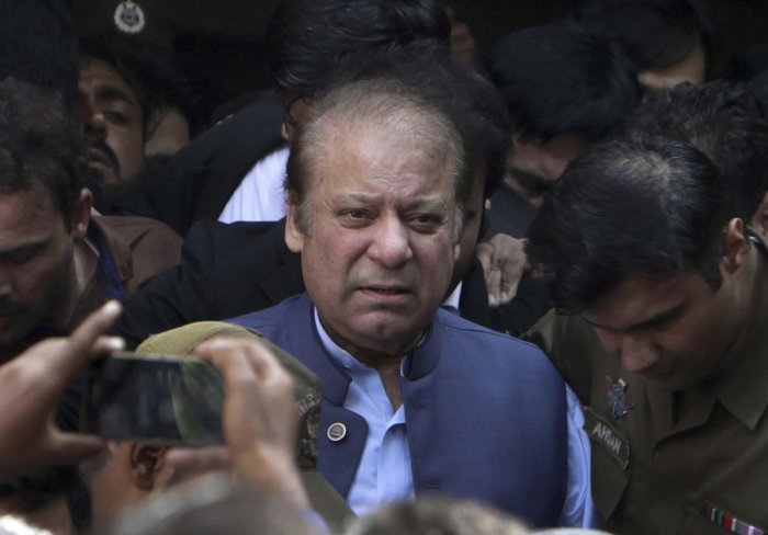 In this Oct. 8, 2018 file photo, former Pakistani Prime Minister Nawaz Sharif leaves after appearing in a court in Lahore, Pakistan. (PTI Photo)