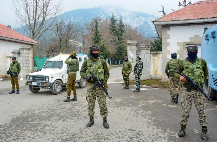 Security personnel stand guard outside the hotel where 25 European Union Parliamentarians were staying and meeting people during their visit to assess the ground situation in Valley after the abrogation of Article 370, in Srinagar, Wednesday, Feb. 12, 202