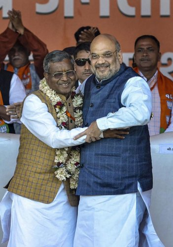 Former Jharkhand chief minister Babulal Marandi (L) greets Union Minister Amit Shah during the merger of Jharkhand Vikas Morcha with the Bharatiya Janata Party (BJP), at an event, in Ranchi, Monday, Feb. 17, 2020. (PTI Photo)