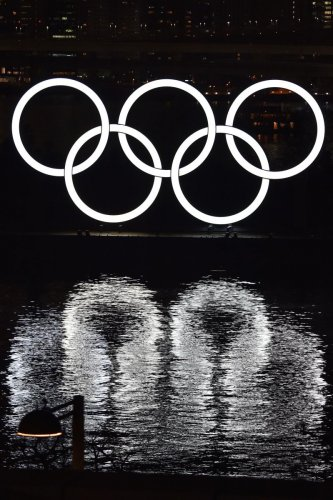 The Olympic rings are displayed off the shore of the Odaiba Marine Park during the Tokyo 2020 Year Commemorative Ceremony in Tokyo on January 24, 2020, to mark six months before the opening of the Tokyo 2020 Olympic Games. (AFP Photo)