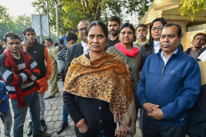 Nirbhaya rape and murder case victim's mother and father at the Patiala House Court, in New Delhi, Thursday, Feb. 13, 2020.
