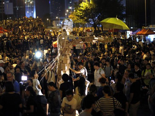 Hong Kong democracy protesters march to China office