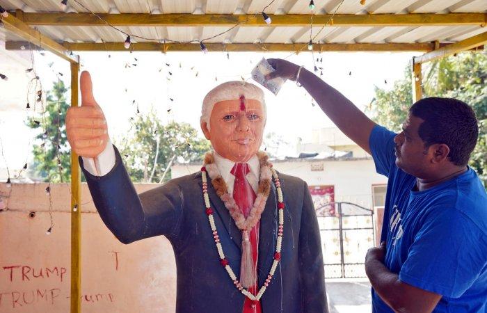 Bussa Krishna, a fan of U.S. President Donald Trump, offers prayers to a statue of Trump. (Reuters file photo)