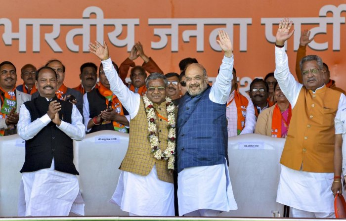 Union Minister and senior BJP leader Amit Shah welcomes Jharkhand Vikas Morcha (JVM-Prajatantrik) chief Babulal Marandi as he merged his JVM-P party with the BJP, in Jagannathpur area of Ranchi, Monday, Feb. 17, 2020. (PTI Photo)