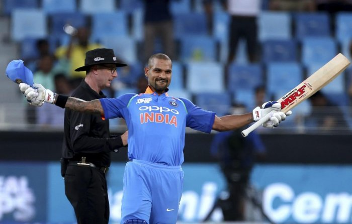 India's Shikhar Dhawan celebrates scoring a century during the one day international cricket match of Asia Cup between India and Hong Kong in Dubai, United Arab Emirates, Tuesday, Sept. 18, 2018. (AP/PTI)