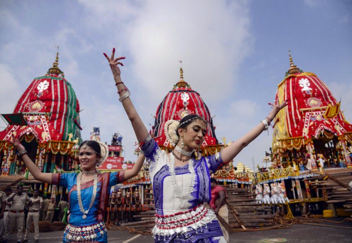 Devotees dance as they participate in the annual Rath Yatra, in Puri. (PTI Photo)