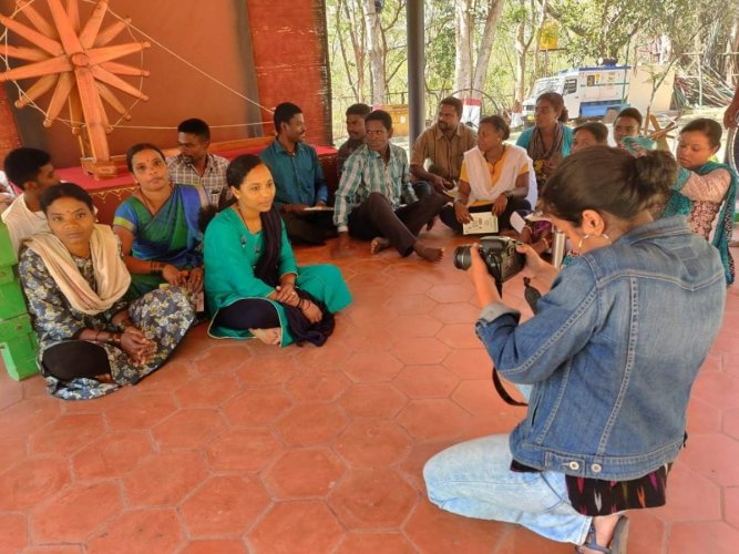 A student records video for a documentary film on Siddi tribals, during Bahuroopi theatre festival, on the premises of Rangayana in Mysuru on Tuesday.