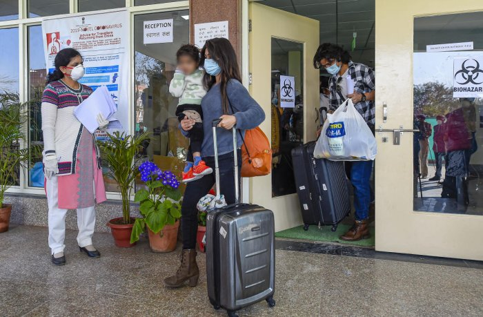 Indians who were air-lifted from Wuhan following out-break of the deadly novel cornavirus, prepare to leave following their release from the ITBP quarantine facility, at Chhawla, in New Delhi, Monday, Feb 17,2020.