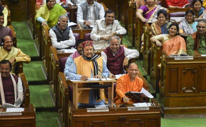 Uttar Pradesh Finance Minister Suresh Khanna presents the State Budget 2020-21 in the UP Legislative Assembly, in Lucknow, Tuesday, Feb18, 2020. Uttar Pradesh Chief Minister Yogi Adityanath is also seen. PTI