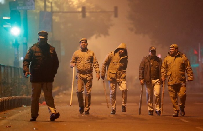 Police officers patrol after a protest against a new citizenship law in Delhi. (Reuters Photo)