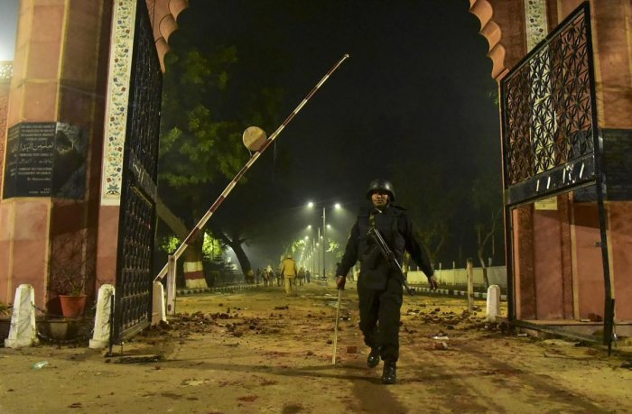 A Security personel stand guard near Aligarh Muslim University (AMU) after the violent protests against Citizenship Amendment Act, in Aligarh. PTI