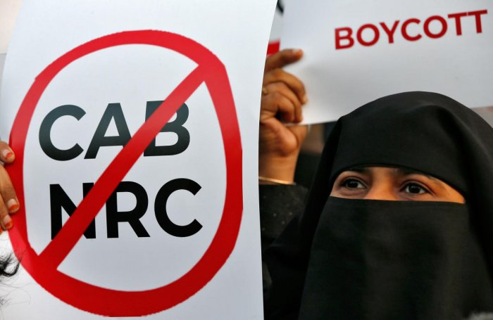 A demonstrator holds a placard during a protest against a new citizenship law and to show solidarity with the students of New Delhi's Jamia Millia Islamia university after police entered the university campus on Sunday following a protest against the new law, in Ahmedabad, India, December 17, 2019. (Reuters photo)