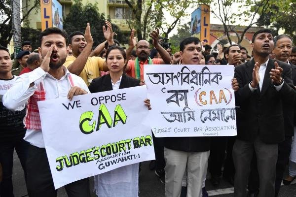 Demonstrators take part in 'Satyagraha' to protest against the Citizenship Amendment Act (CAA) in Guwahati on December 16, 2019. (AFP photo)