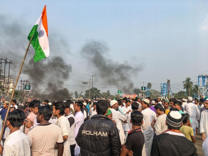 Muslim community members block the National Highway 6 during a protest against NRC and the Citizenship Amendment Bill, in West Bengal's Uluberia district. (PTI photo)