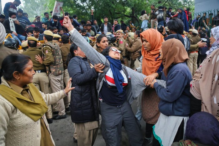 Students of Jamia Millia Islamia University stage a protest against the passing of Citizenship Act. (PTI Photo)