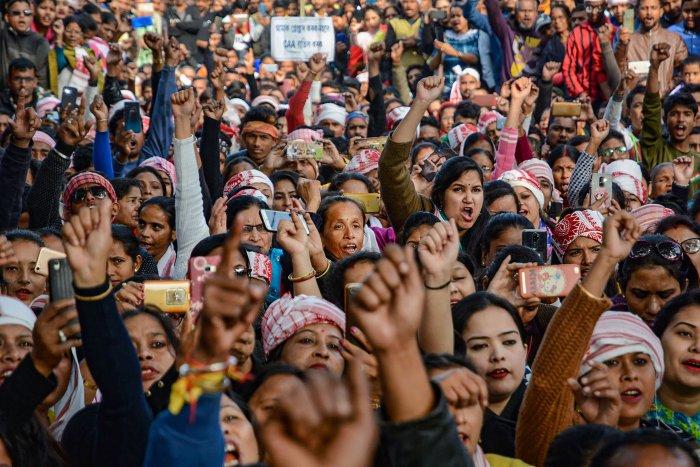 All Assam Students Union (AASU) activists raise slogans against the Citizenship Amendment Act. (PTI Photo)