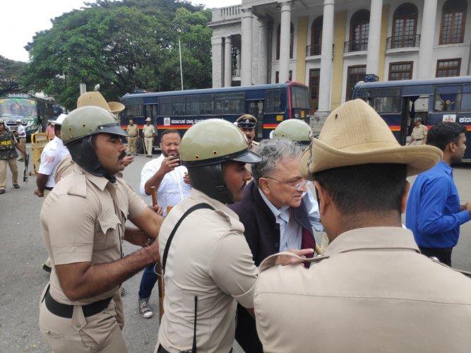 Ramachandra Guha being arrested by the Bengaluru Police.