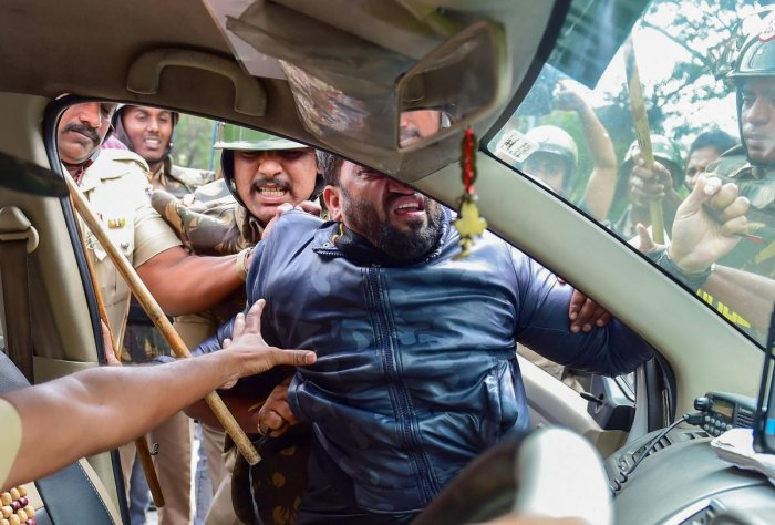 A protestor being detained by police personnel as he defies the prohibitory orders imposed in the area, during a rally against the amended Citizenship Act, in Bengaluru. PTI