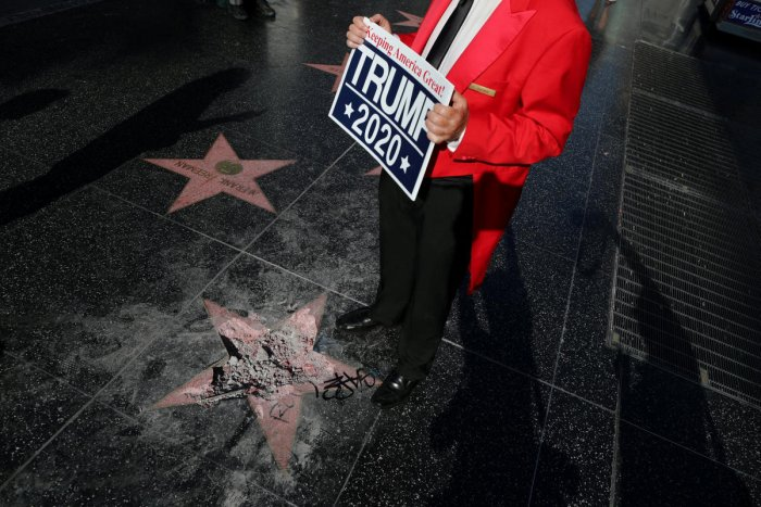 Greg Donovan, 58, stands on President Donald Trump's vandalized star on the Hollywood Walk of Fame in Hollywood, Los Angeles, California, U.S. July 25, 2018. REUTERS/Lucy Nicholson