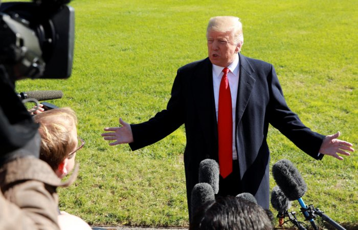 U.S. President Donald Trump speaks to reporters prior to departing on a trip to Houston from the White House in Washington, U.S., October 22, 2018. REUTERS/Kevin Lamarque