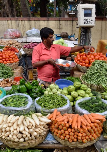 Potatoes, onions and green chillies are getting costlier in city markets than what their prices were before the protests began. Photo/AFP