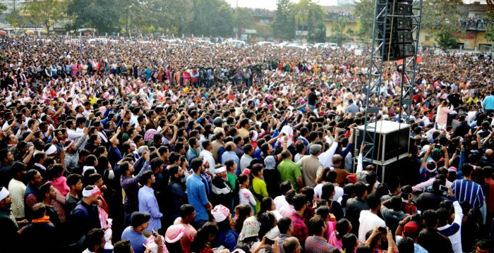 Protestors gather for a concert organised by All Artists of Assam against Citizenship Amendment Act, at AEI playground in Guwahati, Sunday, Dec. 15, 2019. (PTI Photo)